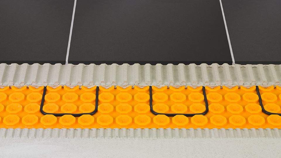 Die bewährte DITRA Entkopplungsmatte bildet die Grundlage für DITRA-HEAT-E.